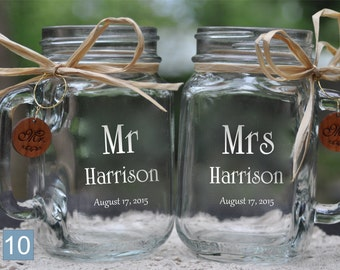 Mr and Mrs Wedding Mason Jar set decorated with raffia and wooden charms.  21 Beautiful Fonts to choose from. Pick handle direction choices