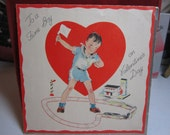 1930's-40's art deco valentine card to a fine boy cute graphics of boy standing and playing with his train set