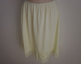 Vintage half slip pale yellow nylon with wide lace hem Shadowline L