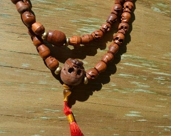 108 mala datewood skull beads one of a kind  M202