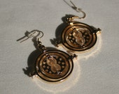 Hermione's Time Turner Earrings - Gold coloured with cream sand inside - 3D spinning -