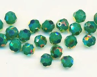 Twelve dazzling limited edition Swarovski crystals: art 5000 - 8 mm - palace green opal AB 2X