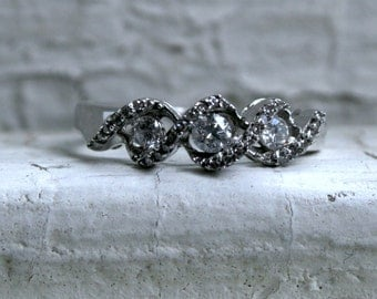 Swirly Vintage 14K White Gold Three Stone Diamond Engagement Ring - 0.58ct.