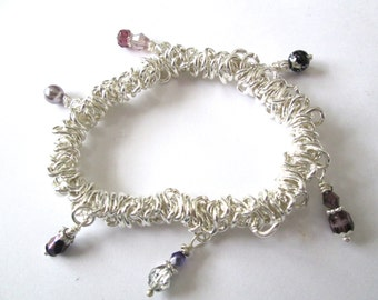 PURPLE charm stretch bracelet, silver links, wire-wrapped glass bead dangles