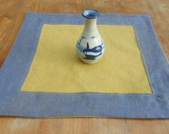 Square blue-and-mustard linen napkin
