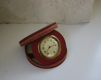 Vintage Travel Clock by Lux in a Round Red Zippered Case