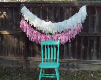 White and pink ribbon garland.