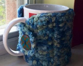 Blue and green coffee mug cozy