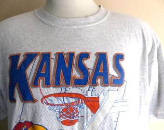 Go KU Jayhawks vintage 80's 90's University of Kansas NCAA Basketball heather grey cartoon mascot print graphic t-shirt white crew neck tee