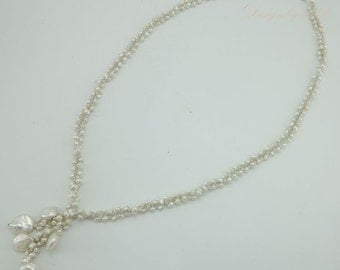 White freshwater pearl long necklace.