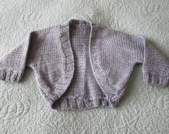 Hand knit baby girl's grey shrug