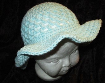 Handmade crochet infant hat with two flower clips