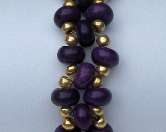 Purple and gold beaded bracelet