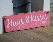 hugs and kisses, wood sign