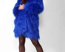 Synthetic long  fur  Fluffy Hood Animal coat with Hat and ears  in blue .saten linin and 2 front pockets.
