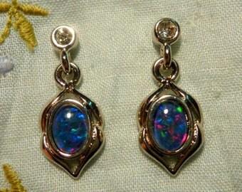 Opal Earrings Rhodium Plate Triplet 7x5 Oval item 80043.
