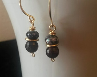 Stormy Weather Earrings.  Faceted freshwater pearl rondelles in irridescent peacock blue rest atop rich garnets, with 18k gold-fill wires.