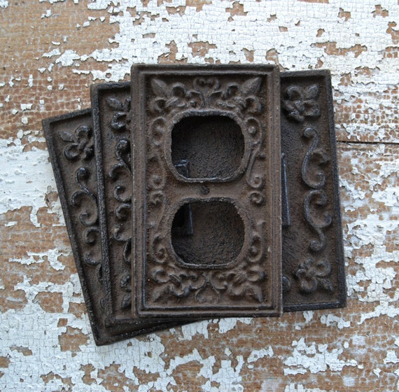 Vintage cast iron plug cover and switchplate ornate metal