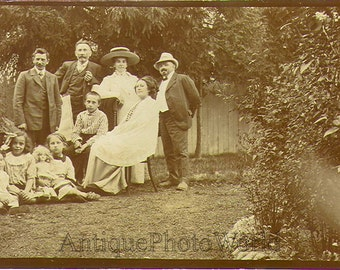 Family with children & doll antique photo