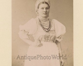 Russia wet nurse in traditional ethnic clothes antique photo
