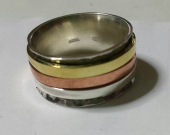 925 silver ring with 3 spinner rings of copper, silver and brass; with personalized text.