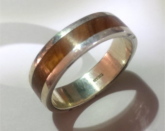 Silver and olive wood ring with personalized text.