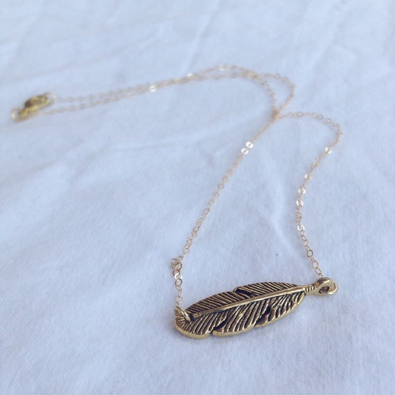 gold feather necklace by pantomimelionjewelry on etsy