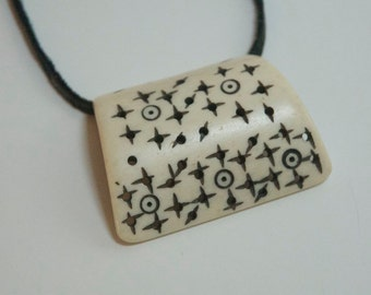 Bone Star necklace with leather