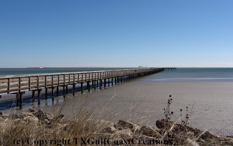 Wooden fishing pier low tide galveston bay blue sky nature for Galveston pier fishing