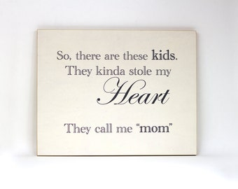 So, there are these kids. They kinda stole my heart. They call me mom. Wood and paper handmade sign.