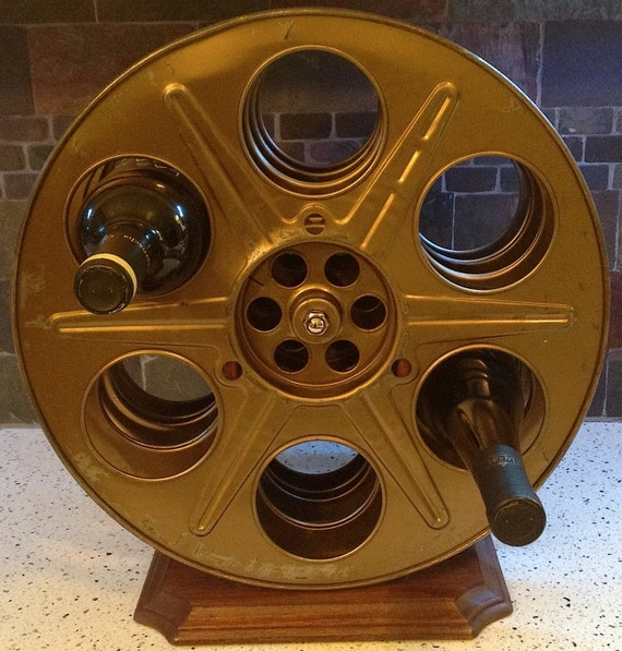 Wine rack made from vintage gold 35mm movie motion picture for Movie reel wine rack
