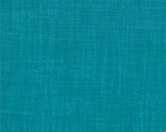 "Turquoise colored fabric from ""Weave"" collection by Moda."