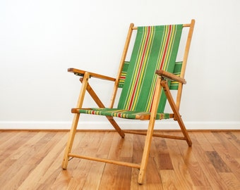 outdoor chair, deck chair, lawn chair, classic Telescope reclining deck chair with armrests, wood frame with green striped fabric, vintage