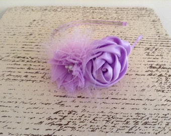Purple flower feather hard headband with pearl rhinestone embellishments.