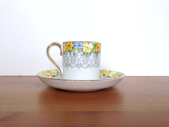 Vintage Crown Staffordshire demitasse cup and saucer flower and scroll