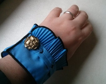 Altered Vintage blue ruffle cuffs into pair of bracelets