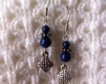 Blue and silver pierced earrings with Celtic knot charms.
