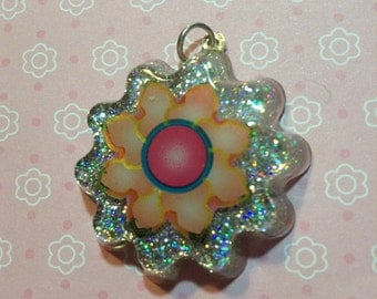 Resin Pendant Flower on Glitter Background
