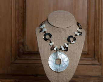 Mother of pearl and sterling focal pendants with mother of pearl, abalone and sterling silver