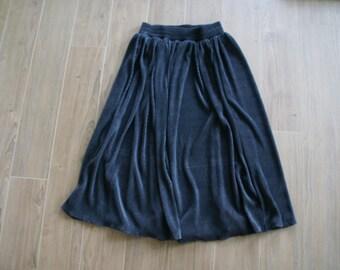 Accordion Pleat Mid Length Skirt