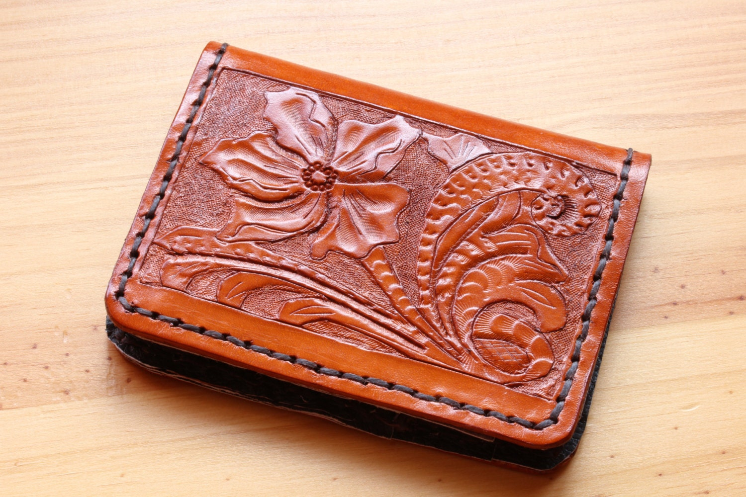 Floral hand carved leather wallets by tinasleathercrafts