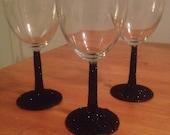 4 Glittered stem wine glasses or beer stiens