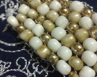 Gold and cream beadwork cuff