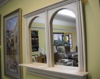 arched double mirror with shelf