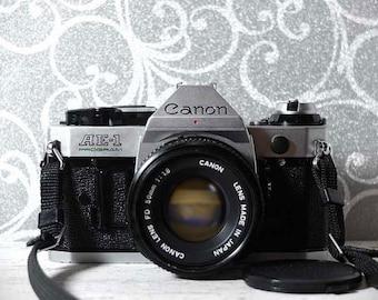 Canon AE-1 Program 35mm SLR camera - With 50mm f1.8 FD lens - vintage camera