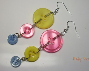 Easter button earrings. Light yellow, pink and blue buttons on trendy dangle earrings. Silver hooks.