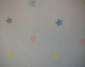 Embroidered cotton batiste with pastel stars