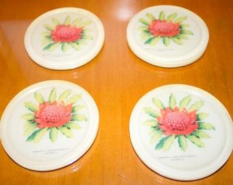 Set of four Waratah, NSW coasters