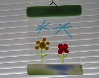 Fused glass suncatcherwall art spring flower and dragonfly with bead accented hanger.