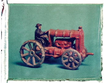 Fine Art photograph of Polaroid Transfer of vintage  Toy Farm Tractor